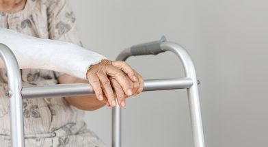 Elderly patient waiting on her walker